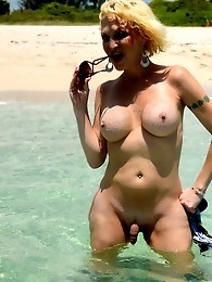 Busty TS Olivia Love posing on the beach