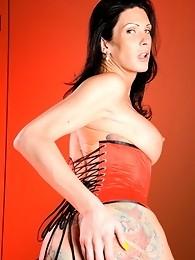 Long-legged Morgan posing in sexy red corset
