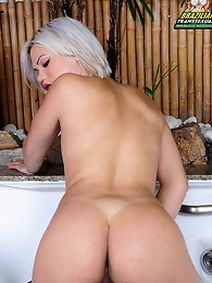 Sexy blonde tranny strips