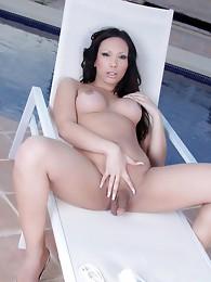 Seductive Holly Harlow posing outdoors