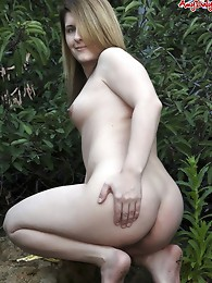 Amy strips and outdoors