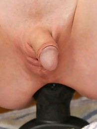 Mandy Mitchel squats down on a huge dong dildo