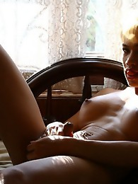 Exotic TS pleasing herself on bed