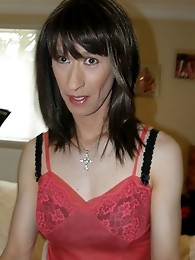 Sexy and slender crossdresser wearing pink negligee