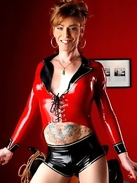 Naughty Jasmine posing in devilishly red latex costume