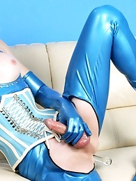 Tara Emory puts on a sexy latex outfit and toys her ass with a glass dildo, exclusively for Shemale Pornstar