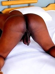 Ugly black shemale stripping her dress and grabbing her phat cock and showing her phat ass