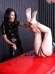 Mistress Lauren straps poor Theodore to her massive domination table and torments his body, working him over with cock and ball toture, and force feed