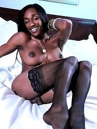 Stunning ebony beauty Natalia Coxxx stripping in bed