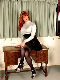 Horny Tgirl Lucimay wearing a tight black corset and silver top