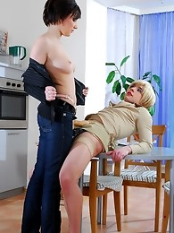 Whitney spotted her sissified boyfriend going about household chores in the kitchen. He looked really impressive in his blonde wig and elegant outfit