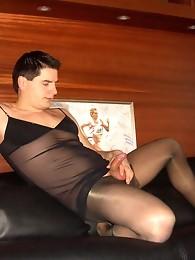 Muscular pantie lover wearing nylon stockings and masturbating