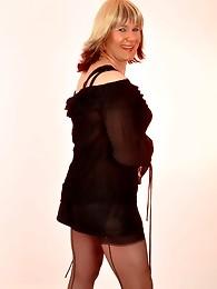 This fun loving crossdresser loves having her nylon covered legs licked