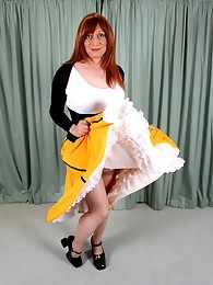 Tgirl Lucimay showing off her long flowing dress and hard cock